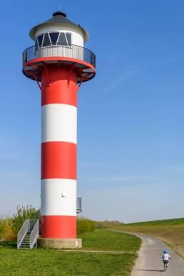Altes Land, Leuchtturm, Elbe,kleiner Junge auf den Fahrrad